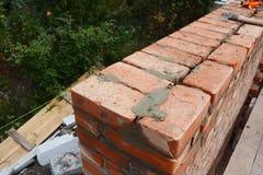 Murerifoto Murerispetsar Hur man bygger en tegelstenvägg arkivbild