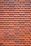 Murez la texture brune orange de mur de tuiles pour le fond Photo libre de droits