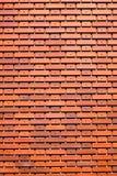 Murez la texture brune orange de mur de tuiles pour le fond Photographie stock