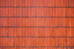 Murez la texture brune orange de mur de tuiles pour le fond Photos libres de droits
