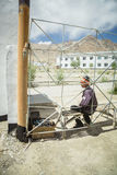 MURGHAB, TAJIKISTAN-JULY 18 2016 Young boy on a bench. MURGHAB, TAJIKISTAN - JULY 18 2016 Young boy on a bench, behind a fence in the school yard stock photography