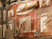 Muri la pittura di Nettuno e di Aimone a Ercolano, Italia fotografia stock