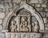 Muri la scultura del tubo principale nella vecchia città di Cattaro Fotografie Stock