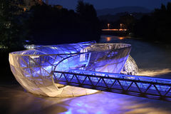 Murinsel in Graz at night. The Island of the Mur in Graz, built in 2003, is a tourist attraction and especially beautiful at night Stock Images