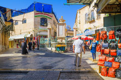 Muristan Complex, the old city of Jerusalem. JERUSALEM, ISRAEL - APRIL 29, 2016: Street scene in the Muristan Complex, with local businesses, locals and visitors Stock Image