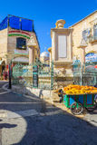Muristan Complex, the old city of Jerusalem. JERUSALEM, ISRAEL - APRIL 29, 2016: Street scene in the Muristan Complex, with local businesses, locals and visitors Stock Photography