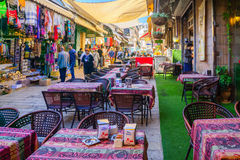 Muristan Complex, the old city of Jerusalem. JERUSALEM, ISRAEL - APRIL 29, 2016: Street scene in the Muristan Complex, with local businesses, locals and visitors Royalty Free Stock Image