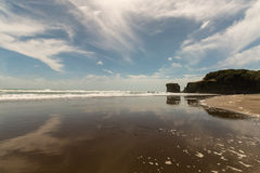 Muriwai beach at low tide Royalty Free Stock Photos