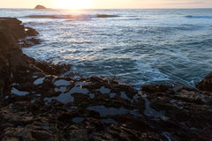 Muriwai Beach. Sunset at Muriwai Beach, New Zealand Stock Photography