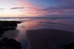 Muriwai Beach. Sunset at Muriwai Beach, New Zealand Stock Images