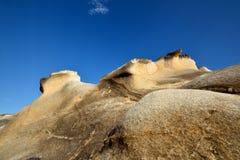 Murken granit i presenterad textur och färg Arkivfoto
