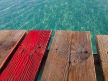 Muro beach on Mallorca island, old wooden pier Royalty Free Stock Image