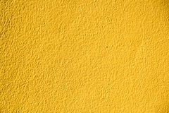 Muro de cemento amarillo Imágenes de archivo libres de regalías