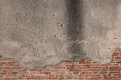 Muro de cemento con el ladrillo Fotografía de archivo