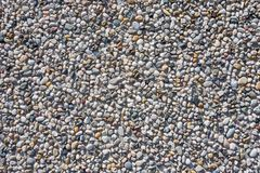 Muro de cimento com os seixos no close-up fotografia de stock royalty free