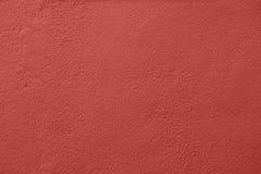 Muro de cimento pintado com uma pintura vermelha imagens de stock