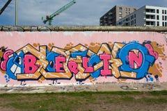 Muro di Berlino con i graffiti di Berlino Immagine Stock Libera da Diritti