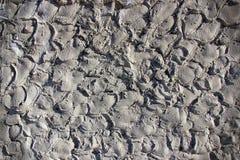 Muro di cemento con un forte sollievo Ben adattato per fondo Fotografie Stock Libere da Diritti