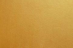 Muro di cemento dell'oro su struttura del fondo fotografia stock
