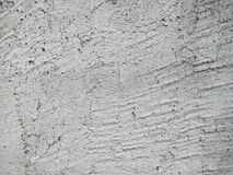 Muro di cemento incrinato e graffiato Immagini Stock