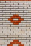 Muro di mattoni bianco con un modello, una struttura o un fondo rossa Immagini Stock Libere da Diritti
