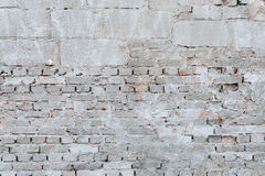 Muro di mattoni con il cappotto della rappresentazione fotografia stock