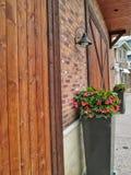 Muro di mattoni con le porte di legno Immagine Stock Libera da Diritti
