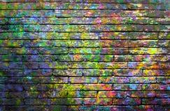 Muro di mattoni con pittura colorata Immagine Stock