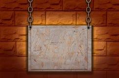 Muro di mattoni con una scheda del segno Immagini Stock Libere da Diritti