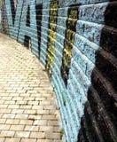 Muro di mattoni dei graffiti Fotografia Stock