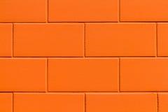 Muro di mattoni dell'arancia del primo piano Fotografie Stock