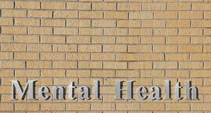 Muro di mattoni di pietra naturale del segno di salute mentale fotografie stock libere da diritti