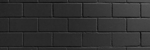 Muro di mattoni dipinto il nero per fondo Immagini Stock Libere da Diritti