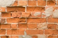 Muro di mattoni fatto della pietra rossa Immagine Stock