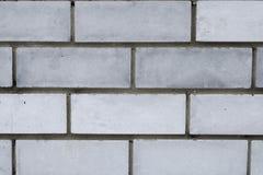 Muro di mattoni grigio urbano Fotografie Stock