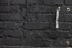 Muro di mattoni nero Immagini Stock