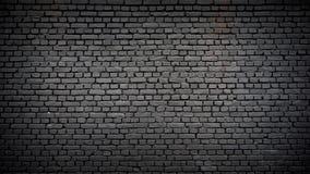 Muro di mattoni nero come fondo Fotografie Stock