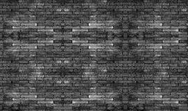 Muro di mattoni nero I blocchetti di pietra neri di struttura Priorità bassa astratta per il disegno fotografia stock
