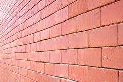 Muro di mattoni rosso. Immagini Stock