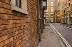 Muro di mattoni rosso della costruzione nella costruzione inglese urbana, ty Fotografia Stock