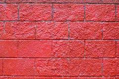 Muro di mattoni ruvido vivo rosso fotografia stock