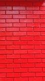 Muro di mattoni verniciato rosso Fotografia Stock