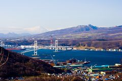 Muroran Harbor from Mt Sokuryo, Hokkaido, Japan. Panoramic view from Mt Sokuryo Muroran: Muroran Harbour and the Hakucho Ohashi Bridge Royalty Free Stock Photos