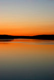 Murphy Cove Sunset. The soft orange glow of the sunset reflected in a tidal inlet near Murphy Cove, Nova Scotia, Canada Stock Photos