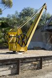 Decommissioned Small Yellow Crane, Murray Bridge, SA. Murray Bridge, South Australia, Australia - August 19, 2017: Old, small, decommissioned crane on the Murray Stock Images