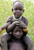 Mursi kids. Mursi tribe kids from Omo Valley, Ethiopia, Africa Royalty Free Stock Photo