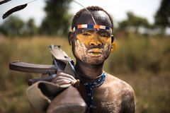 Mursi man with gun over the shoulder Stock Images