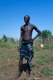 Mursi tribe man in national dress royalty free stock image