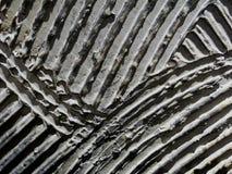 Murslev på dekorativ textur i grå färger i lagerinre fotografering för bildbyråer