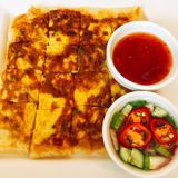 Murtabak. Is Muslim food is type of roti which ingredients is fried, poultry or beef, vagetable, Onion, carrot Royalty Free Stock Photo